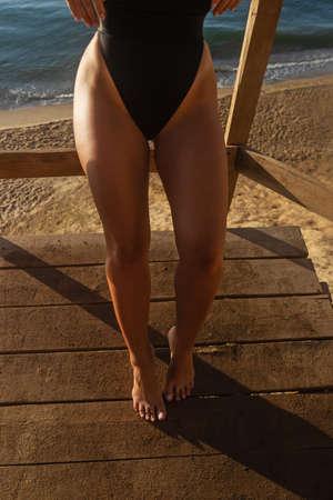 beautiful female legs in the morning sun