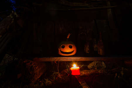 halloween picture with a candle and a pumpkin head