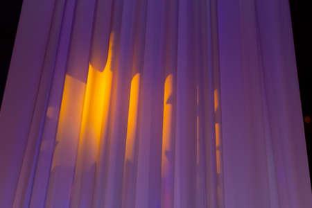 beautiful sunset light illuminates the draped fabric