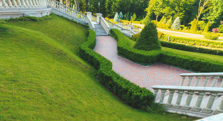 beautiful spring park with steps and lawn