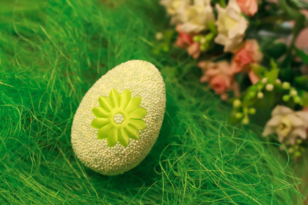 testicles: Decorative egg on green grass. Concepts Easter, eggs, hand made Stock Photo