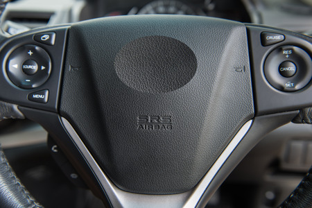 steering: Closeup of Driver Airbag on a car steering wheel