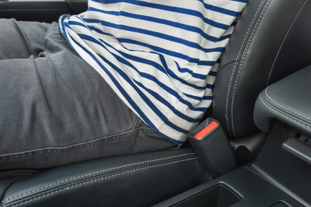 no: Closeup of man driving a car and no use seat belt, closeup of buckle Stock Photo