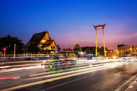 Wat Suthat Thepphaararam and moving light of car passing in the giant swing Stock Photo
