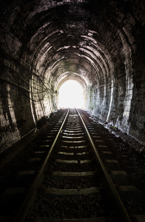 Light at the end of railroad tunnel at Khuntan tunnel, Thailand