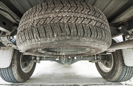 Spare tire for changing under of car   photo
