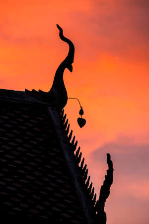 apex: Silhouette of gable apex on the roof of Thailand temple in sunset  Stock Photo