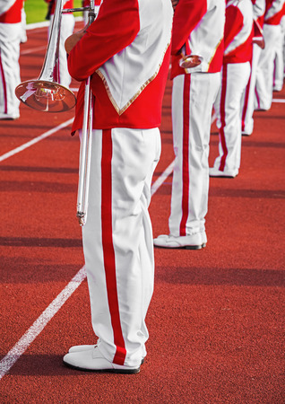Standing rows of marching band students in stadium Stock fotó