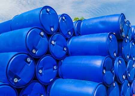 Plastic storage drums stacked up. photo