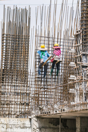 Young woman wearing a protective helmet working on construction site. photo