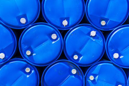 Blue chemical barrels stacked up. Stock Photo