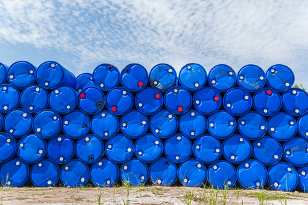 Plastic blue chemical barrels stacked up  Stock fotó