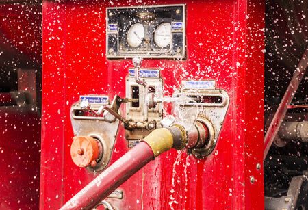 wasting water - water leaking from a connector of hose from fire truck  Stock fotó