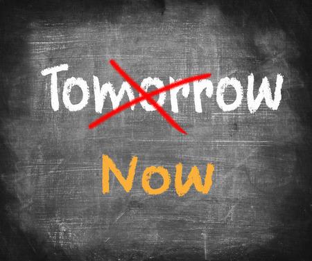 Word Now written instead of Tomorrow. Procrastination concept