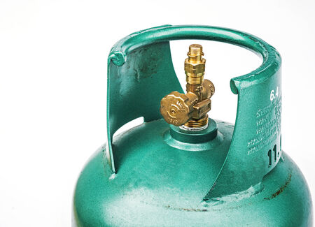 Green gas cylinder isolated on white  photo