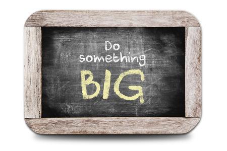 Do Something BIG written on the blackboard photo