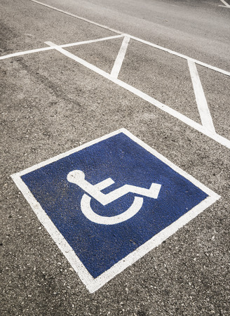 symbolization: Handicapped Symbol Painted on a Parking Spot