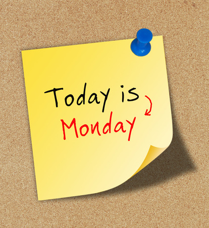 Today is Monday on paper pinned to a cork notice board.