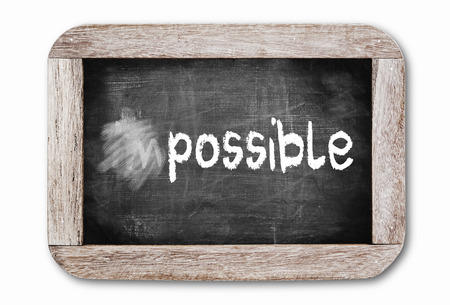 Changing the word impossible to possible.  Stock fotó