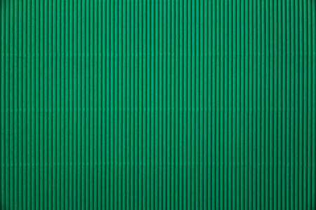 Green corrugated paper background
