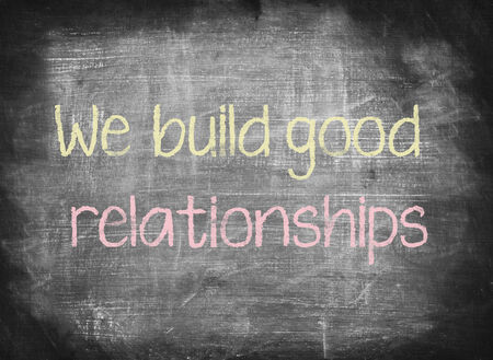 We build good relationships,writing on chalkboard photo