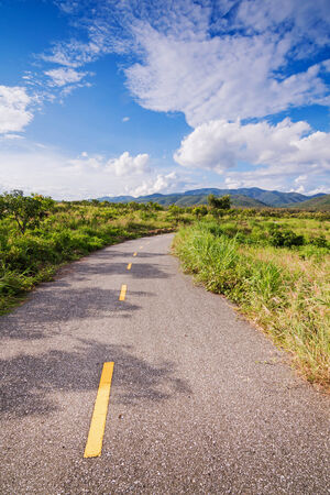 Beautiful road on hillside against a blue sky photo