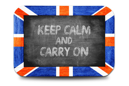 Keep Calm and Carry on , writing on chalkboard. photo