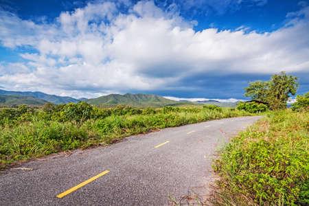 Rural road on hillside against a blue sky  photo
