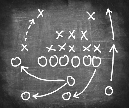 Plan of a football game on a blackboard.