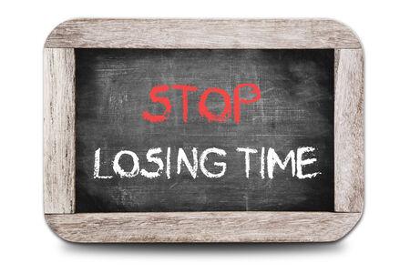 Stop Losing Time handwritten on chalkboard  photo