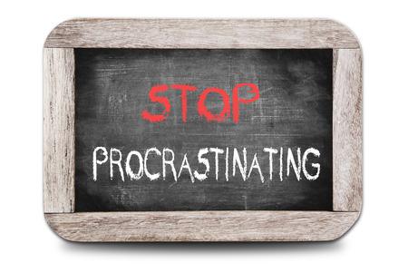 Stop Procrastinating handwritten on chalkboard