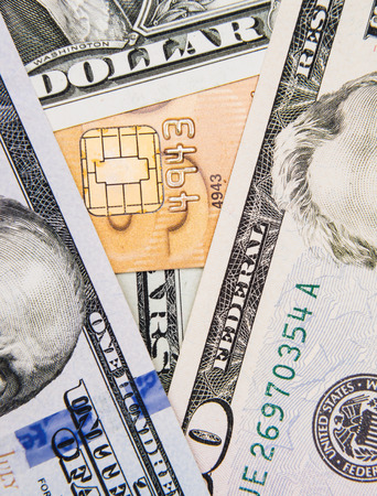 American dollar bills and a credit card concepts of finance photo
