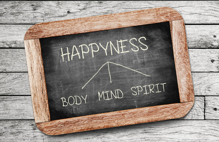 body, mind, spirit - Happyness concept , handwriting on vintage slate blackboard. photo