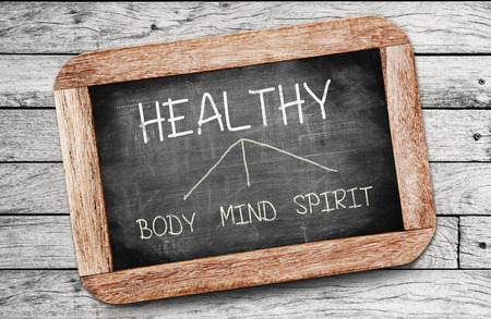 healthy life: Healthy concept. Body, Mind, and Spirit drawing on blackboard Stock Photo