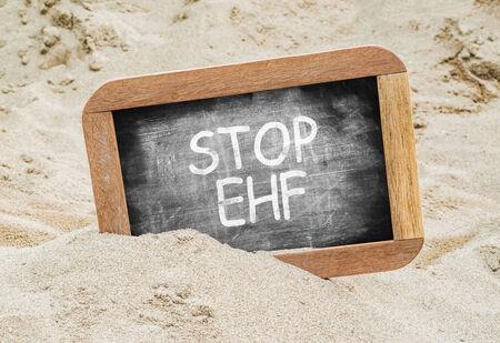 hemorrhagic: Stop EHF (Ebola hemorrhagic fever) on Chalkboard. Stock Photo