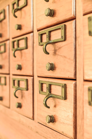 Rows of old wooden drawers photo