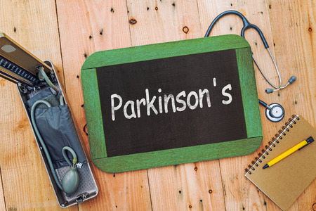 parkinson's: Word Parkinsons on chalkboard , with sphygmomanometer and stethoscope Stock Photo