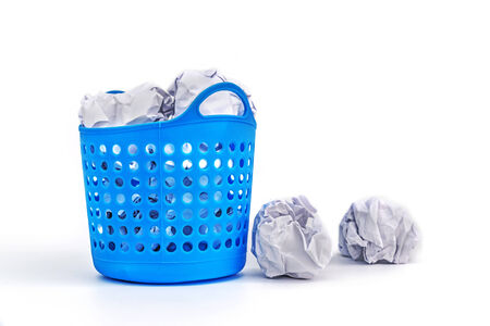 meaningless: Trash basket filled with crumbled paper isolated on white background