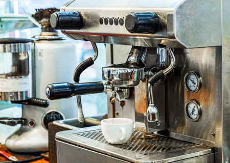 Coffee machine making espresso in a coffee shop. Stock Photo