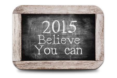 believe: 2015 Crea que usted puede escrito en la pizarra Foto de archivo