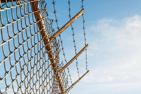 keep gate closed: Fence with barbed wire Stock Photo