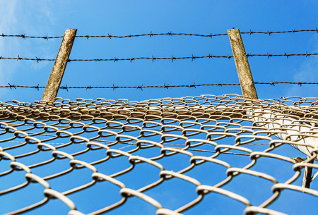 Fence with barbed wire Stock fotó