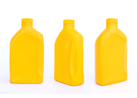 Plastic canisters with machine oil isolated on white background. photo