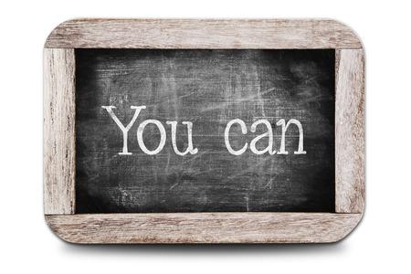 tu puedes: Puede escrito en la pizarra Foto de archivo