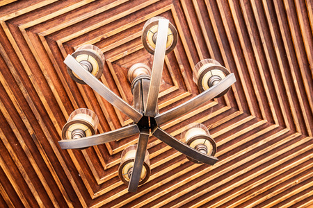 wooden  ceiling: antique chandelier on wooden ceiling
