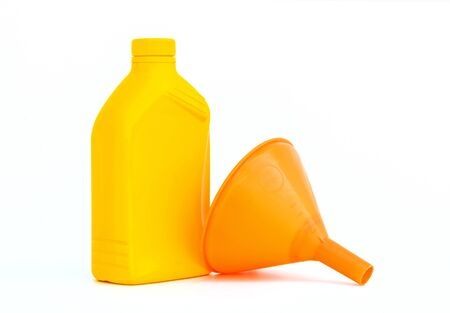 Lubricants plastic bottle and funnel on white background Stock Photo