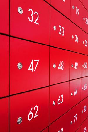 Red individual metal postal boxes photo