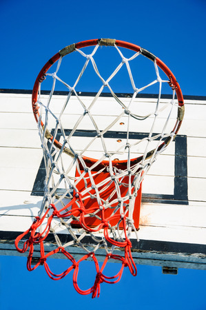 Outdoor Basketball Hoop close up against a blue sky. photo
