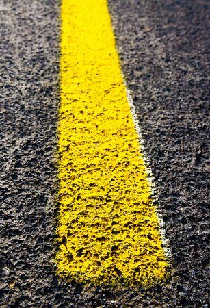 yellow line: Yellow line detail of highway. Stock Photo