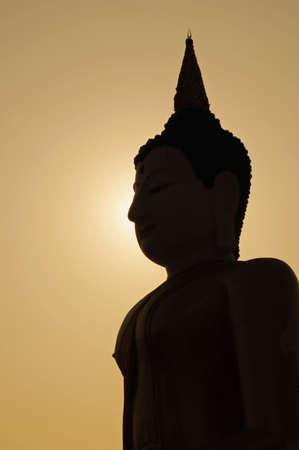buddha face: Silhouette of a big buddha sculpture.